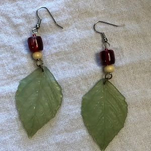 Dangly green leaf earrings with red and wood beads
